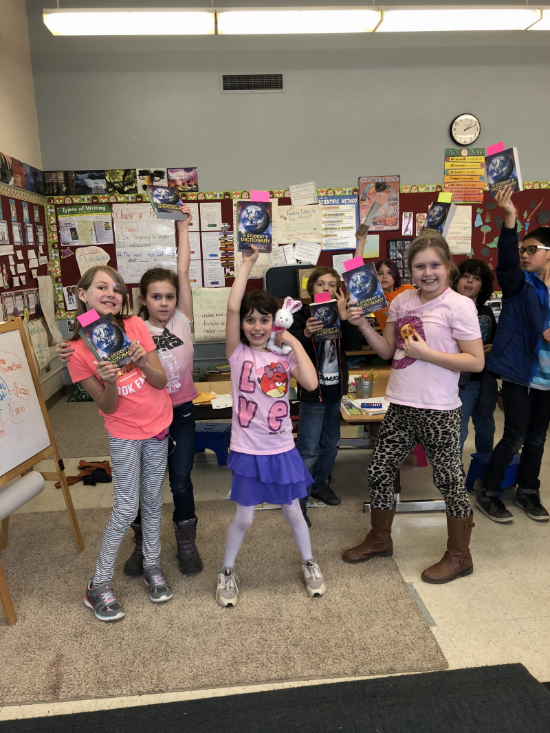 Happy 3rd graders with new Rotary dictionaries